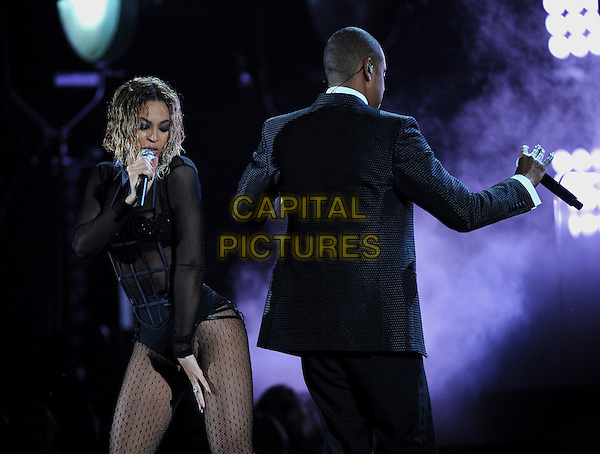 LOS ANGELES, CA - JANUARY 26 : (L-R) Beyonce and Jay-Z perform onstage at The 56th Annual GRAMMY Awards at Staples Center on January 26, 2014 in Los Angeles, California. <br /> CAP/MPI/PG<br /> &copy;PGMicelotta/MediaPunch/Capital Pictures