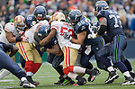 Seattle Seahawks running back Marshawn Lynch is gang tackled by San Francisco 49ers linebackers Blake Costanzo, NaVorro Bowman  at  CenturyLink Field in Seattle, Washington on December 24, 2011. Providing blocks are Seahawks offensive linemen, Breno Giacomini (68), Max Unger (60) and Robert Gallery. The 49ers came from behind to beat the Seahawks 19-17. ©2011 Jim Bryant Photo. All Rights Reserved.