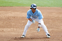 Connor Joe #6 of the University of San Diego Toreros leads off of first base during a game against the Loyola Marymount Lions at Page Stadium on April 5, 2013 in Los Angeles, California. (Larry Goren/Four Seam Images)