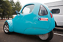 "A side view of Sparrow by Myers Motors (formerly Corbin Motors) - a one person electric vehicle with three wheels, a ""Powered by American Electrons"" bumper sticker and a vanity plate 'EV HOV' (EV = electric vehicle, HOV = high-occupancy vehicle). HOV is also known as carpool that can refer to vehicles or lanes that require at least two people, sometimes three per vehicle. Electric vehicles are allowed to use the lane even with one occupant. Electric Vehicle Rally in Palo Alto, hosted by the Silicon Valley Chapter of the Electric Auto Association, Palo Alto, California, USA"