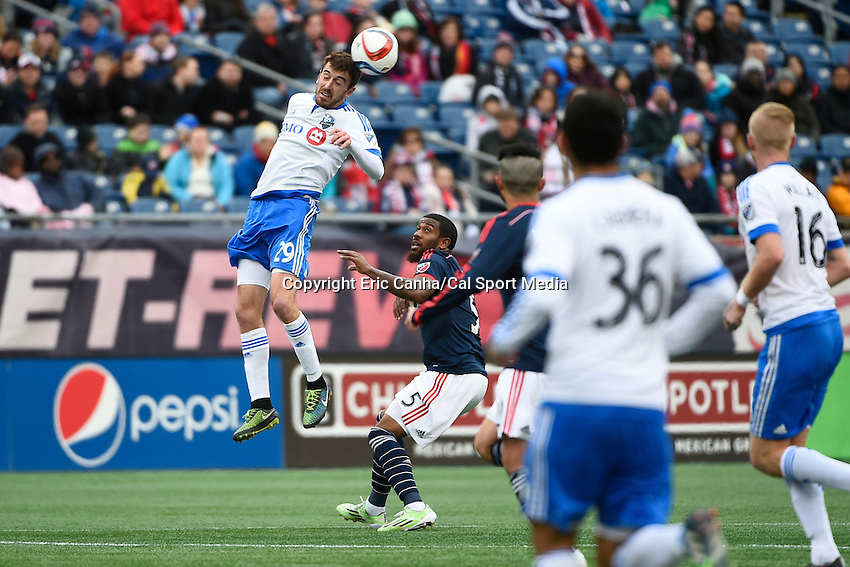 March 21, 2015 - Foxborough, Massachusetts, U.S. - Montreal Impact midfielder Eric Alexander (29) heads the ball during the MLS game between the Montreal Impact and the New England Revolution held at Gillette Stadium in Foxborough Massachusetts. The Revolution and the Impact ended the game tied 0-0. Eric Canha/CSM