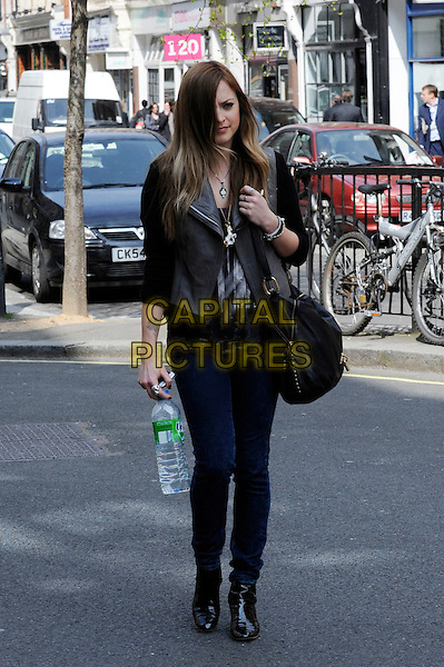 FEARNE COTTON.Spotted walking down Great Portland Street, London, England..April 15th, 2010.full length jeans denim black jacket grey gray bag purse boots bottle water.CAP/IA.©Ian Allis/Capital Pictures.