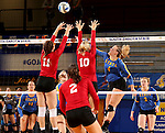 BROOKINGS, SD - SEPTEMBER 25:  Rachel Schmidt #11 and Lindsey Brown #10 from the University of South Dakota try to block a kill attempt on Ashlynn Smith #4 from South Dakota State University during their match Sunday afternoon at Frost Arena. (Photo by Dave Eggen/Inertia)