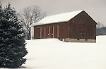 Barn on wintery snowy day in Union County with blue spruce tree.