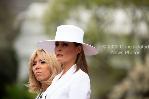 First lady of the United States Melania Trump and first lady of France Brigette Macron on the South Lawn of the White House during the French State Visit to the United States on April 24, 2018 in Washington, DC. Credit: Alex Edelman / Pool via CNP