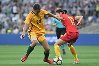 26 November 2017, Melbourne - SAM KERR (20) of Australia and ZUE JIAO (13) of China PR compete for the ball during an international friendly match between the Australian Matildas and China PR at GMHBA Stadium in Geelong, Australia.. Australia won 5-1. Photo Sydney Low