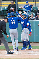 Rancho Cucamonga Quakes Brayan Morales (10) congratulates Devin Mann (33) after hitting a home run during a California League game against the Visalia Rawhide on April 9, 2019 in Visalia, California. Visalia defeated Rancho Cucamonga 8-5. (Zachary Lucy/Four Seam Images)