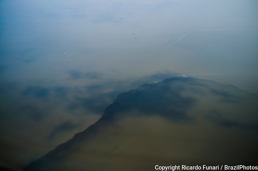 Polluted river with sewer pours dirty water in Guanabara bay, Rio de Janeiro, Brazil.