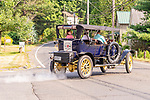 WOODBURY, CT. 16 July 2019-071619 - A 1912 Stanley Steamer  gets back to the road after stopping at the Hotchkissville Firehouse in Woodbury on Tuesday. The Steamers need to stop every 35-50 miles to fill up with water as they operate by steam. A large group of owners of Stanley Steamers from around the country have gathered driving around the area touring the Litchfield Hills. Bill Shettle Republican-American