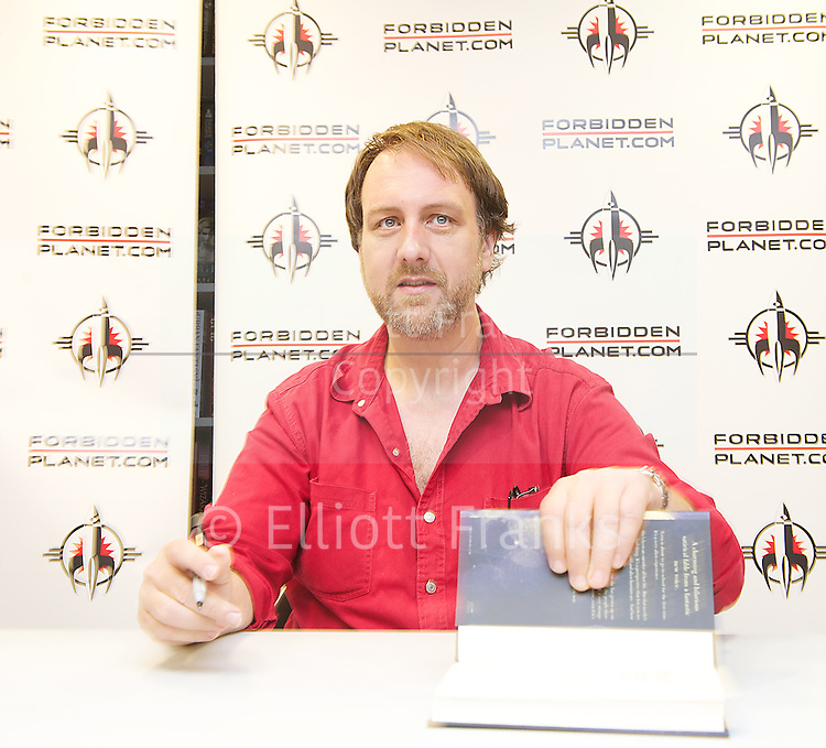 Mitch Benn <br /> personal appearance and book signing for his new novel <br /> TERRA <br /> at Forbidden Planet, London, Great Britain <br /> 20th July 2013 <br /> <br /> <br /> Mitch Benn <br /> <br /> Mitchell John Benn is a British musician, comedian and author known for his comedy rock songs performed on BBC radio. He is a regular contributor to BBC Radio 4's satirical programme The Now Show, and has hosted other radio shows.<br /> <br /> Photograph by Elliott Franks