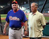 Phillies Manager Charlie Manuel talks with GM Pat Gillick on Thursday May 22nd at Minute Maid Park in Houston, Texas. Photo by Andrew Woolley / Four Seam Images.