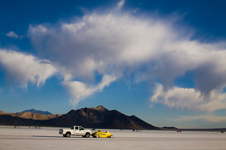 "© 2010  David Burnett .Contact Press Images.212 695 7750..August 16, 2010.Wendover, Utah.Bonneville Salt Flats race course. Arriving of cars and teams.  Running as seen from starting line,and the 4 mile timing area.  Overall shots from starting line of LONG Course;  5 1/2 mile point of long course: cars deploying parachutes..""City of Salt Lake"" and Butch Graham at sunset"