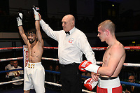 Quaise Khademi (white shorts) defeats Georgi Georgiev during a Boxing Show at York Hall on 10th February 2018