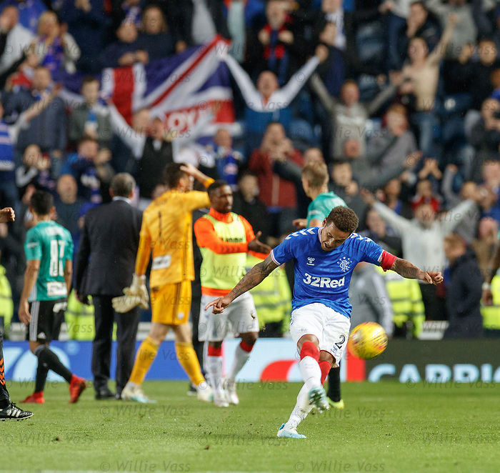 29.08.2019 Rangers v Legia Warsaw: James Tavernier boots the match ball into the crowd at full time