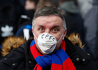 7th March 2020; Selhurst Park, London, England; English Premier League Football, Crystal Palace versus Watford; Crystal Palace fan poses with a dusk mask inside Selhurst Park due to the global outbreak of COVID-19 coronavirus