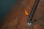 A flame burns off excess fuel at an oil drilling operation in the Bakken formation in western North Dakota.