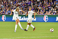 Orlando, FL - Saturday March 24, 2018: Utah Royals defender Katie Bowen (6) takes a shot as her teammate Utah Royals midfielder Desiree Scott (11) watches during a regular season National Women's Soccer League (NWSL) match between the Orlando Pride and the Utah Royals FC at Orlando City Stadium. The game ended in a 1-1 draw.