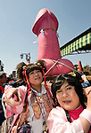Participants carry a gigantic 2.5 meter pink phallus on their shoulders during the Kanamara Festival in Kawasaki, Japan. Kanamara means metal phallus, so named after a story dating back hundreds of years in which a local blacksmith made an iron phallus to protect a girl who was thought to be curse. Today, the festival participants are largely prostitutes STDs.