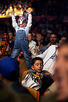 A young fan wearing a Luchador (fighter) mask. Lucha Libre is a style of wrestling started in Mexico in 1933. The name means Free Fight, and matches tend to be focussed on spectacle and theatre with fans cheering for their favourite characters, who wear masks while jumping from the ropes, flipping opponents, and occasionally crashing into the crowd..©Jacob Silberberg/Panos/Felix Features.