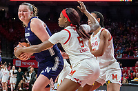 COLLEGE PARK, MD - JANUARY 26: Kaila Charles #5 and Stephanie Jones #24 of Maryland defend against Abbie Wolf #21 of Northwestern during a game between Northwestern and Maryland at Xfinity Center on January 26, 2020 in College Park, Maryland.