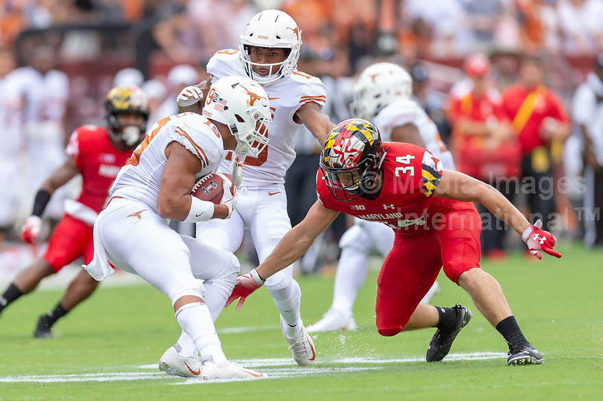 Landover, MD - September 1, 2018: Maryland Terrapins running back Jake Funk (34) goes in to tackle Texas Longhorns defensive back Brandon Jones (19) during game between Maryland and No. 23 ranked Texas at FedEx Field in Landover, MD. The Terrapins upset the Longhorns in back to back season openers with a 34-29 win. (Photo by Phillip Peters/Media Images International)