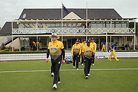 The Firebirds walk out for the Ford Trophy One Day match (round five) between Wellington Firebirds and Otago Volts at Bert Sutcliffe Oval in Lincoln, New Zealand on Friday, 29 November 2019. Photo: Martin Hunter / lintottphoto.co.nz