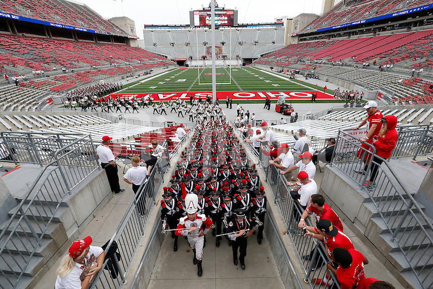 The Ohio State Marching Band heads to St. John Arena for the Skull Session before the start of an NCAA football game between the Ohio State Buckeyes and the Western Michigan Broncos  at Ohio Stadium in Columbus, Ohio, on Saturday, September 26, 2015. (Columbus Dispatch photo by Fred Squillante)