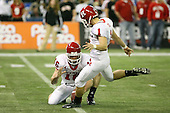 January 5th, 2008:  Rutgers place kicker Jeremy Ito (1) kicks the extra point as Andrew DePaola (16) holds during the third quarter of the International Bowl at the Rogers Centre in Toronto, Ontario Canada...Rutgers defeated Ball State 52-30.  ..Photo By:  Mike Janes Photography