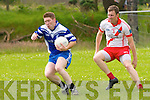 Annascaul Shane Foley in possession of the ball closely watched by An Ghaeltacht Colm Ó Muircheartaigh during the County Senior Football League Div. 3 match at Annascaul GAA Grounds on Sunday afternoon.
