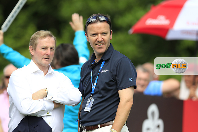 An Taoiseach Enda Kenny and James Finnegan European Tour watch play during Sunday's Final Round of the 2014 Irish Open held at Fota Island Resort, Cork, Ireland. 22nd June 2014.<br /> Picture: Eoin Clarke www.golffile.ie