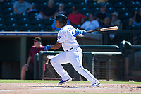 Surprise Saguaros designated hitter Meibrys Viloria (9), of the Kansas City Royals organization, follows through on his swing during an Arizona Fall League game against the Salt River Rafters on October 9, 2018 at Surprise Stadium in Surprise, Arizona. Salt River defeated Surprise 10-8. (Zachary Lucy/Four Seam Images)