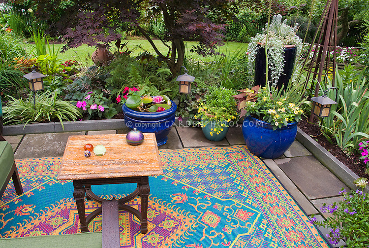 Creating an outdoor room with rugs and pots plant for Japanese outdoor plants