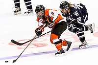 RIT's Ariane Yokoyama (8) goes past Yale's Jen Matichuk in the third period. RIT defeated Yale 3-0 at Blue Cross Arena in Rochester, New York on October 20, 2012