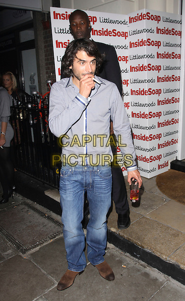 MARC ELLIOTT .Leaving the Inside Soap Awards 2009 at Sketch, London, England, UK, September 28th 2009..departures full length drink jeans denim cigarette smoking blue shirt grey gray .CAP/AH.©Adam Houghton/Capital Pictures.