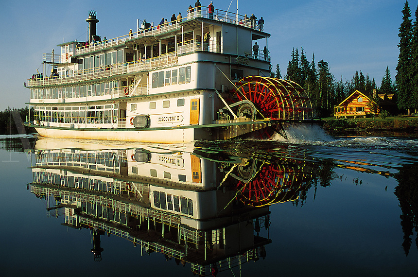 A paddle boat travels on the Chena River. Alaska.