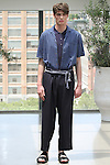 Model Connor poses in an outfit from the Deveaux Spring Summer 2017 collection on July 13 2016, during New York Fashion Week Men's Spring Summer 2017.