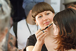Backstage hair and makeup prep for the Feng Chen Wang Spring Summer 2019 collection fashion show, at Industria Superstudio in New York City on July 10, 2018; during New York Fashion Week: Men's Spring Summer 2019.