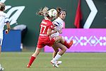 19 June 2015: Kansas City's Erika Tymrak (right) and McCall Zerboni (77) challenge for the ball. The Portland Thorns FC hosted FC Kansas City at Providence Park in Portland, Oregon in a National Women's Soccer League 2015 regular season match. The game ended in a 1-1 tie.