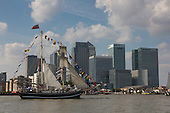 London, UK. 9 September 2014. Tall ships passing Canary Wharf. The Tall Ships that have taken part in the Royal Greenwich Tall Ships Festival 2014 leave Greenwich in a Parade of Sail down the River Thames.
