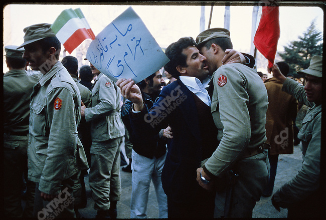 "Followers of the shah and Prime Minister Bakhtiar hold a ""pro-Constitution"" rally. The sign held by the man above reads, ""We respect the law."" Tehran, January 24, 1979"