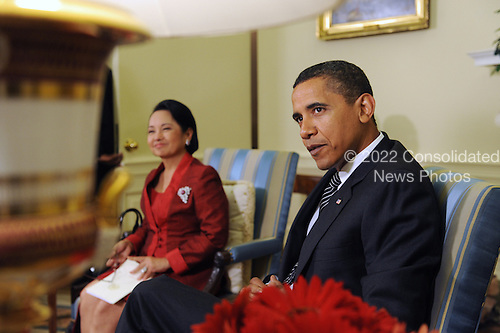 Washington, DC - July 30, 2009 -- United States President Barack Obama (R) meets with President Gloria Macapagal-Arroyo (L) of the Philippines in the Oval Office of the White House in Washington DC, USA 30 July 2009.  Obama and Arroyo discussed security, the environment and Myanmar (Burma) among other issues.   .Credit: Michael Reynolds - Pool via CNP
