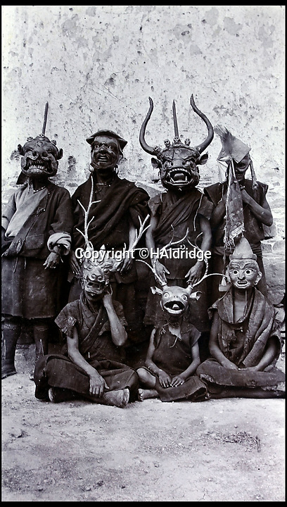 BNPS.co.uk (01202 558833)Pic: HAldridge/BNPS<br /> <br /> Tibetan actors wearing their ritual masks.<br /> <br /> Game tales from the hills...remarkable album shows British attempts to win over newly invaded Tibet by playing sport's straight from the playing fields of England.<br /> <br /> A collection of photos have come to light which show the people of the remote Himalayan nation of Tibet embracing one of the traditional British pastimes - a sports day.<br /> <br /> The archive of more than 500 photos was collated by a British Lieutenant Colonel, R C MacGregor, of the Indian Medical Service, who was present in Tibet between 1904 and 1912.<br /> <br /> These photos are one of the earliest examples of the British attempting to win 'the hearts and minds' of a native population as they were taken during the controversial Younghusband expedition to the distant Buddhist country.<br /> <br /> The archive also features four never before seen photos of the Dalai Lama returning to Tibet in 1912 after his exile ended.