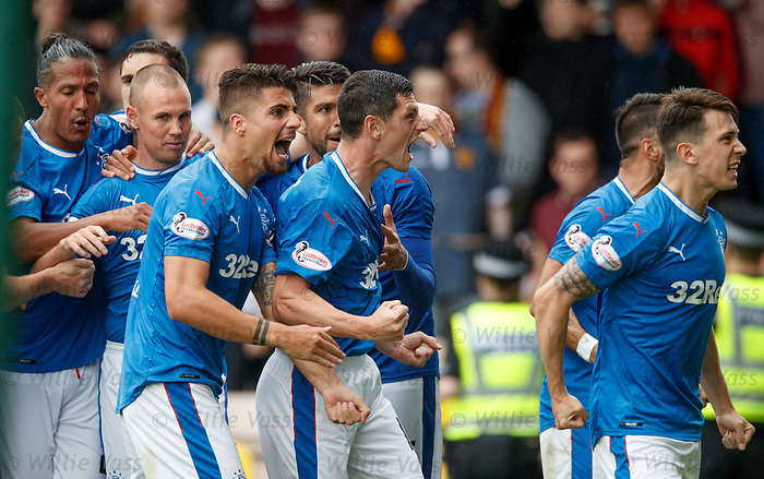 Fabio Cardoso and Graham Dorrans show their feelings to the Rangers fans after Rangers score the winner