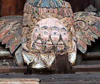 BNPS.co.uk (01202 558833)<br /> Pic: PhilYeomans/BNPS<br /> <br /> Unique - The restoration also revealed from under years of varnish a previously unknown carving thought to depict the holy trinity in the form of a three headed image carried by an angel.<br /> <br /> Doom finally has its day! - A 500 year old 'Day of Judgement' painting, that has survived Henry VIII th, the Puritans and even Victorian prudery has been restored to its former glory.<br /> <br /> Thought to be the largest medieval 'Doom' painting in the country, the striking image been painstakingly restored after a tumultuous 500 year history on the chancel arch of St Thomas Becket church in Salisbury.<br /> <br /> Originally painted in the 15th century, the chancel was white-washed during the Reformation before being uncovered nearly 300 years later in the early 19th century. <br /> <br /> Prudish Victorian's shocked by the naked images then recovered it before it finally re-emerged in 1881 as opinions relaxed. <br /> <br /> Experts have spent three months conserving the faded painting, which included injecting lime slurry behind areas of paint to affix them again to the wall. and delicately 'touching up' in places before finishing it with varnish to bring out its colour.<br /> <br /> Most pre 16th century churches and cathedrals in Britain would have been plastered with religious images and iconography to encourage their often illiterate congregation to good behaviour.<br /> <br /> But during Henry VIII th Protestant Reformation churches were stripped of all graven imagery and the paintings were either whitewashed over or completely destroyed.<br /> <br /> Because of this very few works still survive today making the Salisbury fresco a truly remarkable survivor.<br /> <br /> The restoration is part of a larger set of works at the historic church which are due to cost £1.5million.