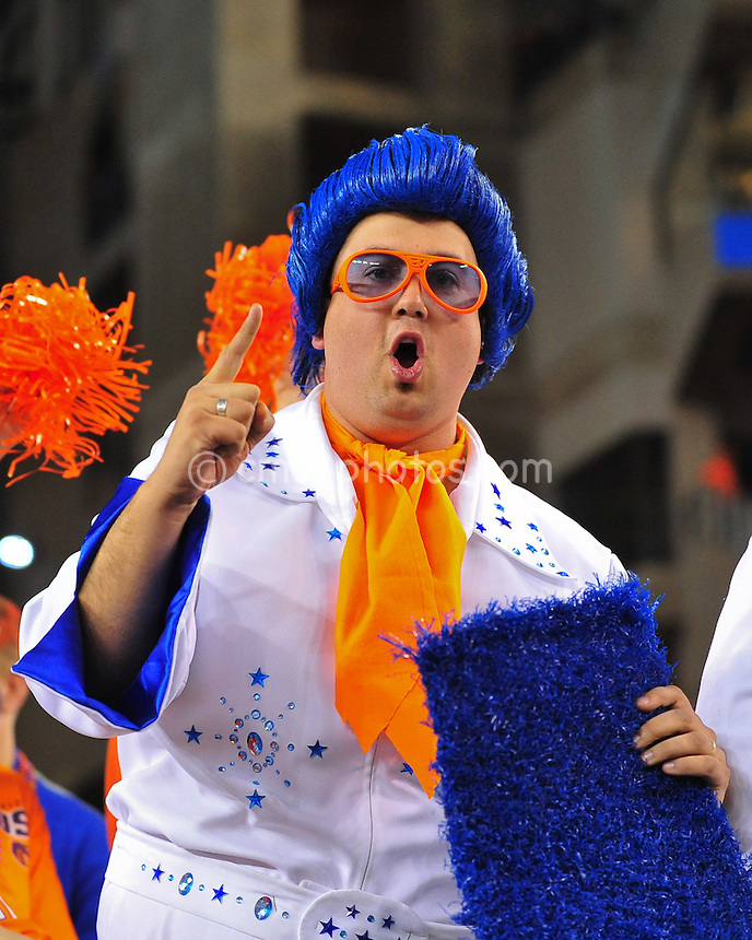 Jan 4, 2010; Glendale, AZ, USA; A Boise State Broncos fan holds up a piece of blue turf in the 1st quarter of a game against the TCU Horned Frogs in the 2010 Fiesta Bowl.  The Broncos defeated the Horned Frogs 17-10 at University of Phoenix Stadium.