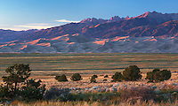 Sunset at the Great Sand Dunes National Park Colorado seen from a distance.