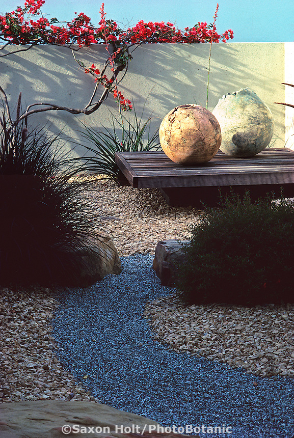 Bench and urns in modern Santa Barbara roof top garden with raked gravel - credit Isabelle Greene