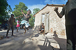 Ten-year old Erm Jouna Dalmas jumps rope in front of her family's new home in Picmy, a village on the Haitian island of La Gonave where Service Chr&eacute;tien d&rsquo;Ha&iuml;ti is working with survivors of Hurricane Matthew, which struck the region in 2016. Holding the rope are her brothers Dwendy and Vestander as her mother looks on.<br /> <br /> SCH, a member of the ACT Alliance, is helping families like this one repair or rebuild their homes on the island.