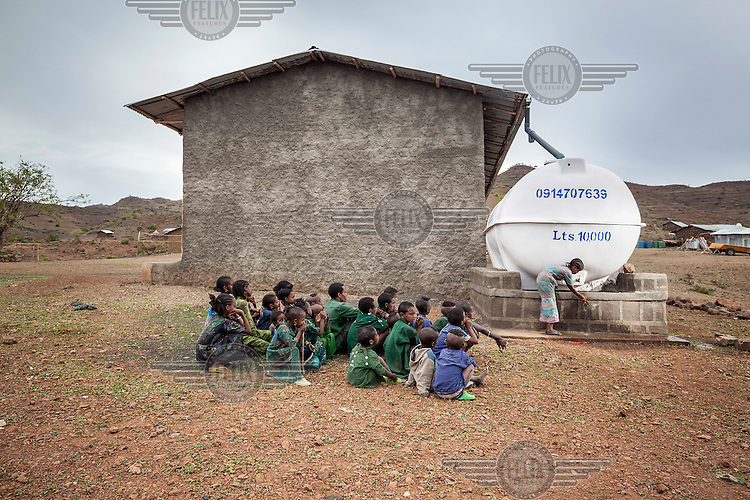 A school girl washes her hands with water from the school's roof top water harvesting project. Some 10,000 litres of water are stored in the tank that is used by the school for drinking and cleaning. <br /> Ethiopia is experiencing its worst drought in over 50 years. The emergency started early in 2015 with the failure of the February-April 'Belg' rains and was further compounded by the main 'Kiremt' rain season (July-September) being erratic and poor, caused by an exceptional El Nino event.