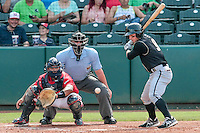 during eyes a pitch along with Oklahoma City RedHawks catcher Carlos Perez (20) during the Pacific Coast League game against the at Chickashaw Bricktown Ballpark on June 23, 2013 in Oklahoma City ,Oklahoma.  (William Purnell/Four Seam Images)